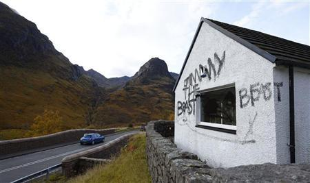 Graffiti and slogans are seen painted on Alt-na-reigh, the cottage owned by the late BBC presenter Jimmy Savile, in Glen Coe, Scotland October 29, 2012. REUTERS/Russell Cheyne