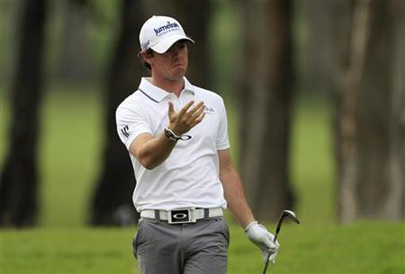 Rory McIlroy of Northern Ireland reacts after hitting a shot on the sixth fairway during the first day of the Hong Kong Open golf tournament November 15, 2012. REUTERS/Tyrone Siu