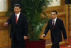 China's new Politburo Standing Committee members Xi Jinping (L) and Li Keqiang arrive to meet with the press at the Great Hall of the People in Beijing, November 15, 2012. China's ruling Communist Party unveiled its new leadership line-up on Thursday to steer the world's second-largest economy for the next five years, with Vice President Xi Jinping taking over from outgoing President Hu Jintao as party chief. REUTERS/Carlos Barria