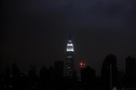 A blacked out New York City skyline is seen from Brooklyn, New York, October 29, 2012 as Hurricane Sandy made landfall in the northeastern United States. REUTERS/Gary He