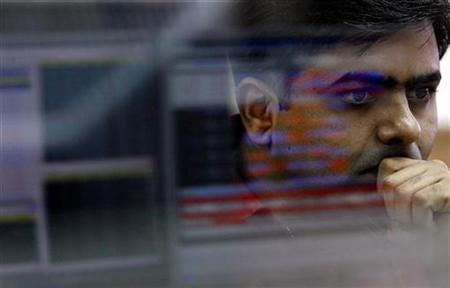 A broker reacts while trading at a stock brokerage firm in Mumbai November 6, 2008. REUTERS/Arko Datta/Files