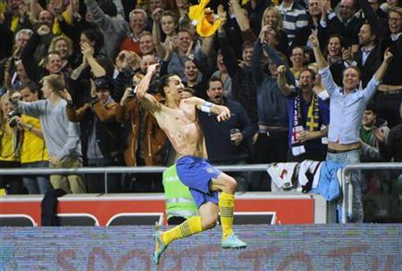 Sweden's Zlatan Ibrahimovic celebrates after Sweden's 4-2 win in the friendly soccer match against England at the Friends Arena in Stockholm November 14, 2012. REUTERS/Claudio Bresciani/Scanpix