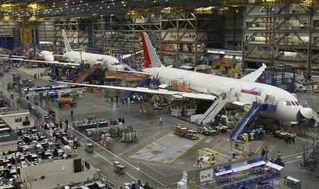 787 Dreamliners, including an airplane for Air India (R), are seen on the production line at the Boeing Commercial Airplane manufacturing facility in Everett, Washington February 14, 2011. REUTERS/Anthony Bolante/Files