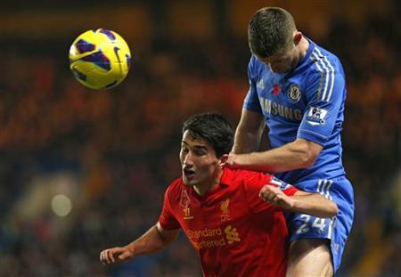 Nuri Sahin (L) of Liverpool and Gary Cahill of Chelsea jump for a header during their English Premier League soccer match at Stamford Bridge in London November 11, 2012. REUTERS/Andrew Winning