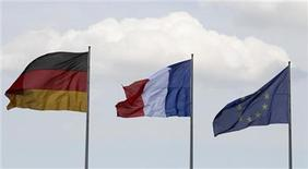 Flags of Germany, France and the European Union flutter in the wind before the meeting of new French President Francois Hollande and German Chancellor Angela Merkel in Berlin, May 15, 2012. REUTERS/Tobias Schwarz