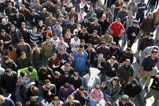 Антиправительственная демонстрация в Аммане 14 ноября 2012 года. Массовые протесты в Иордании, вспыхнувшие в ответ на повышение цен на топливо властями страны, привели к первой крови - погиб один из протестующих и еще десятки получили ранения, сообщили очевидцы и службы безопасности страны. REUTERS/Muhammad Hamed