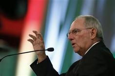 German Finance Minister Wolfgang Schaeuble speaks at the economy forum of the Sueddeutsche Zeitung newspaper in Berlin, November 15, 2012. REUTERS/Thomas Peter (GERMANY - Tags: POLITICS MEDIA)