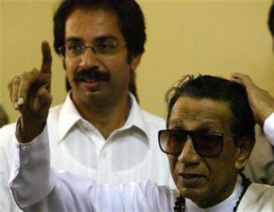 Bal Thackeray, chief of the hardline Hindu Shiv Sena party, gestures to the crowd after he cast his vote in Mumbai April 26, 2004. REUTERS/Sherwin Crasto/Files