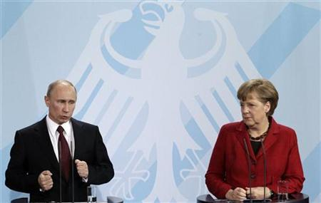 German Chancellor Angela Merkel and Russian President Vladimir Putin address the media after talks in Berlin, June 1, 2012. REUTERS/Tobias Schwarz