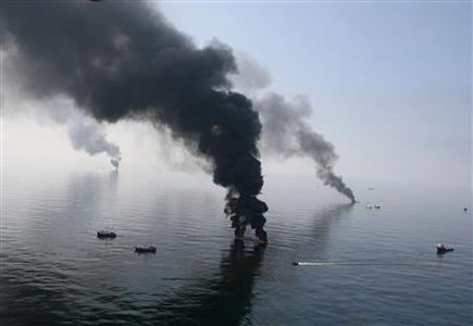 Smoke billows from a controlled burn of spilled oil from the Deepwater Horizon platform in the Gulf of Mexico in this file photo taken June 13, 2010. REUTERS/Sean Gardner/Files
