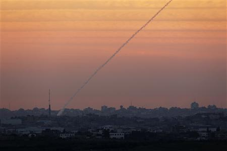 A smoke trail is seen as a rocket is launched from the northern Gaza Strip November 15, 2012. REUTERS/ Darren Whiteside