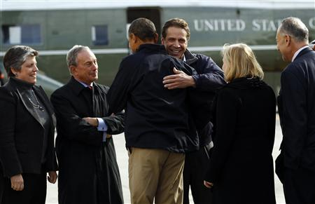 U.S. President Barack Obama gets a hug from New York Governor Andrew Cuomo (facing camera) upon his arrival in New York City to view recovery efforts from Hurricane Sandy, November 15, 2012. REUTERS/Kevin Lamarque