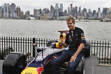 Formula One defending world champion Sebastian Vettel poses during a news conference after taking a preview lap around the Grand Prix of America course at Port Imperial in Weehawken, New Jersey, June 11, 2012. REUTERS/Shannon Stapleton