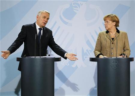 French Prime Minister Jean-Marc Ayrault and German Chancellor Angela Merkel address a joint news conference at the Chancellery in Berlin November 15, 2012. REUTERS/Wolfgang Rattay