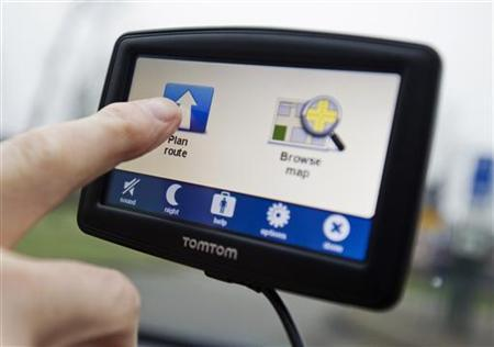 A TomTom navigation device is seen in this photo illustration taken in Amsterdam February 28, 2012. REUTERS/Robin van Lonkhuysen/United Photos