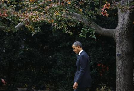 U.S. President Barack Obama walks towards Marine One on the South Lawn at the White House before departing for New York, November 15, 2012. REUTERS/Larry Downing