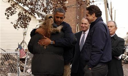 U.S. President Barack Obama hugs resident Debbie Ingenito as he tours a hurricane battered Staten Island neighborhood in New York November 15, 2012. REUTERS/Kevin Lamarque