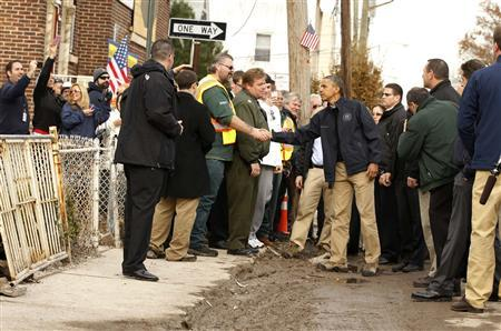 U.S. President Barack Obama (C) shakes hands during a visit to a hurricane battered Staten Island neighborhood in New York November 15, 2012. REUTERS/Kevin Lamarque