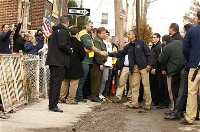 Obama tours New York storm damage, consoles victims