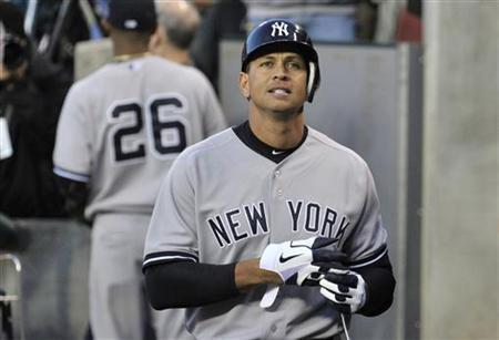 New York Yankees' Alex Rodriguez reacts after returning to the dugout after his first at-bat in the sixth inning during Game 4 of the MLB ALCS baseball playoff series against the Detroit Tigers in Detroit, Michigan, October 18, 2012. REUTERS/Mike Cassese