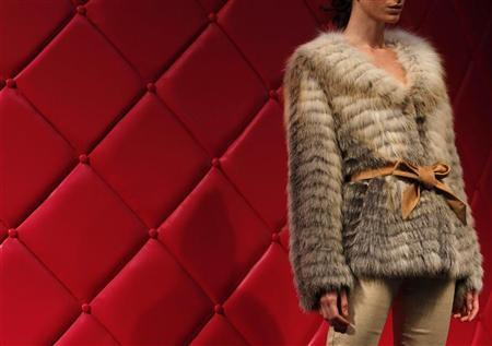A model presents a fur outfit during a Hong Kong Fur Federation show as part of the Hong Kong Fashion Week for Fall/Winter 2011 January 18, 2011. REUTERS/Bobby Yip