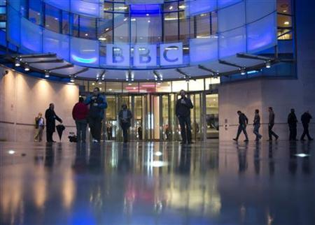 People arrive at, and leave, the BBC headquarters at New Broadcasting House in central London November 12, 2012. REUTERS/Neil Hall