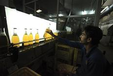 A worker at Pakistan's lone beer maker, Murree Brewery, checks the quality of bottles at the factory in Rawalpindi November 10, 2012. Murree Brewery, established in 1860 by British colonial rulers to supply beer to their troops, is desperately looking for business overseas to hedge against its uncertain domestic market. Prohibition was imposed in Pakistan in 1977, and non-Muslims and foreigners must obtain a government permit to purchase alcohol at designated retailers, which are mainly upscale hotels. Picture taken November 10, 2012. REUTERS/Faisal Mahmood