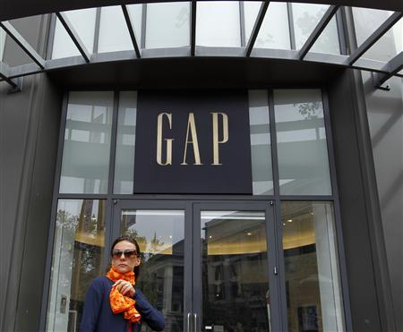 A woman walks past the Gap flagship store in San Francisco, California in this August 18, 2011 file photo. REUTERS/Robert Galbraith/Files