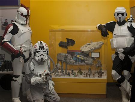 Undated handout photo of Stars Wars fans from the 501st and Rebel Legions, which are costume organizations run by fans, posing in front of Star Wars action figure cases at the National Toy Hall of Fame at The Strong museum in Rochester, New York. Darth Vader and other characters from the ''Star Wars'' movies, as well as the game of dominoes were chosen on November 15, 2012, to be included in the Toy Hall of Fame at The Strong, a children's and cultural history museum in western New York. REUTERS/Courtesy The Strong, Rochester, New York/Handout