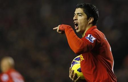 Liverpool's Luis Suarez celebrates after scoring during their English Premier League soccer match against Newcastle United at Anfield in Liverpool, northern England, November 4, 2012. REUTERS/Phil Noble