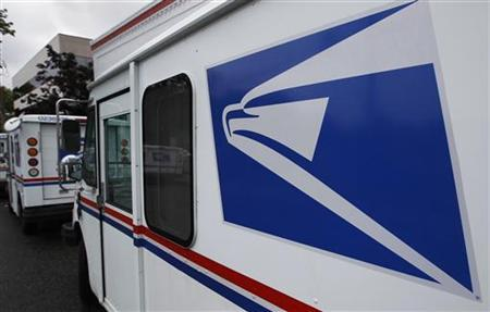 United States Postal Service trucks are seen in Manhasset, New York August 1, 2012. REUTERS/Shannon Stapleton
