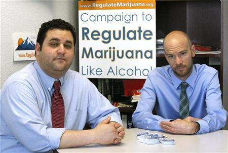Mason Tvert (L) and Brian Vicente pose in their offices in Denver, Colorado, May 25, 2012. The two are the leaders of a campaign calling for the legalization of an ounce of marijuana, and creating a legal framework so the drug's sale could be regulated and taxed by the state as alcohol is today. REUTERS/Rick Wilking