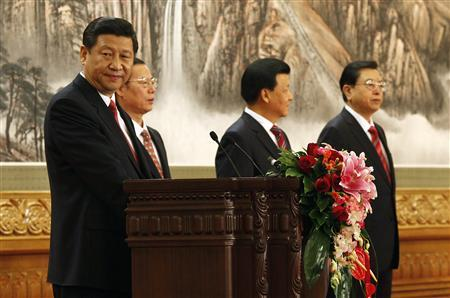 Newly-elected General Secretary of the Central Committee of the Communist Party of China (CPC) Xi Jinping (L) speaks as he meets with the press with other new Politburo Standing Committee members (from 2nd L to R) Zhang Gaoli, Liu Yunshan and Zhang Dejiang at the Great Hall of the People in Beijing, November 15, 2012. REUTERS/Carlos Barria