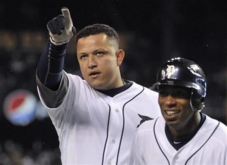 Detroit Tigers' Miguel Cabrera (L) and Austin Jackson celebrate Cabrera's two run home run against the San Francisco Giants in the third inning during Game 4 of the MLB World Series baseball championship in Detroit, Michigan, October 28, 2012. REUTERS/Mike Cassese