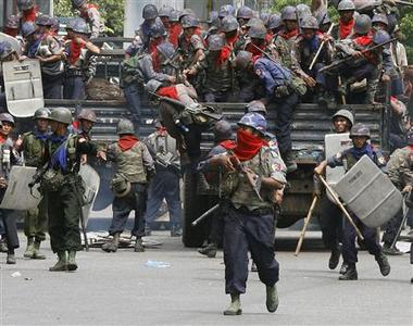 Riot police and military personnel arrive at the scene of an anti-government protest in Yangon's city centre in this September 28, 2007 file photo. REUTERS/Adrees Latif/Files