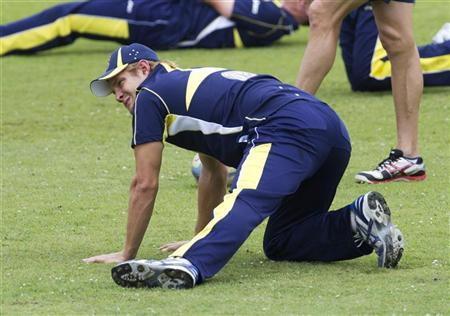 Australia's Shane Watson stretches during a training session before their final One Day International (ODI) cricket match against South Africa in Durban October 26, 2011. REUTERS/Rogan Ward