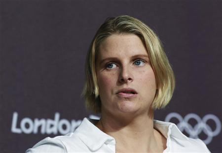 Australian swimmer Leisel Jones looks on during a news conference at the Media Press Centre in London 2012 Olympic Park in Stratford, east London July 23, 2012. REUTERS/Olivia Harris