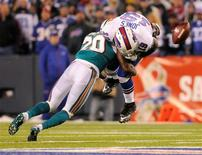 Miami Dolphins safety Reshad Jones (20) causes Buffalo Bills wide receiver Donald Jones (19) to fumble in the fourth quarter of their NFL football game in Orchard Park, New York November 15, 2012. REUTERS/Doug Benz