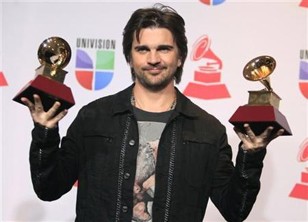 Juanes poses backstage with the awards for best long form music video and album of the year for ''MTV Unplugged'' during the 13th Latin Grammy Awards in Las Vegas, Nevada, November 15, 2012. REUTERS/Steve Marcus