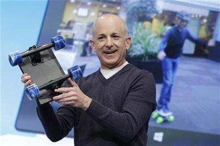 Steven Sinofsky holds a Surface with skateboard wheels attached to show the strength of the device during the launch event for Microsoft Windows 8 in New York, October 25, 2012. REUTERS/Lucas Jackson/Files