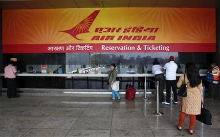 Customers stand at an Air India reservation office at the domestic airport in Mumbai May 8, 2012. REUTERS/Vivek Prakash/Files