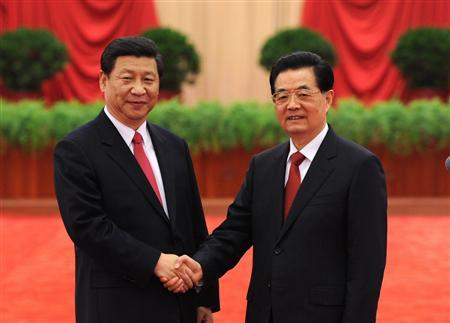 Chinese President Hu Jintao (R), and Xi Jinping, newly-elected General Secretary of the Central Committee of the Communist Party of China (CPC), also chairman of the CPC Central Military Commission, shake hands as they meet with delegates, special delegates and observers to 18th National Congress of the CPC at the Great Hall of the People in Beijing, China, November 15, 2012. Picture taken November 15, 2012. REUTERS/Xinhua/Li Xueren