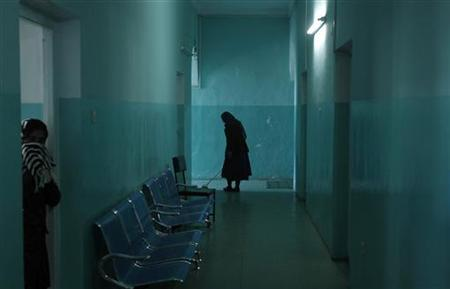 An employee cleans the corridor of a women's ward at a mental hospital in Kabul November 14, 2012. REUTERS/Adnan Abidi