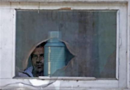 A patient looks out from his ward at a mental hospital in Kabul November 11, 2012. REUTERS/Adnan Abidi