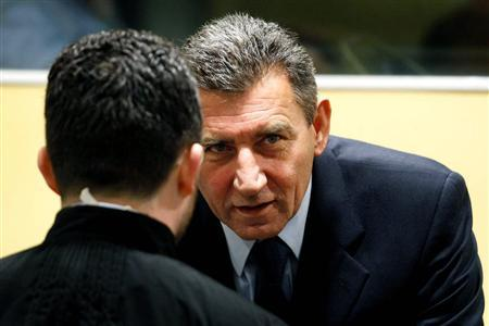 Ante Gotovina (R), who was commander in the Split district of the Croatian army, talks in the courtroom of the International Criminal Tribunal for the former Yugoslavia (ICTY) before his appeal judgement in The Hague November 16, 2012. REUTERS/Bas Czerwinski/Pool
