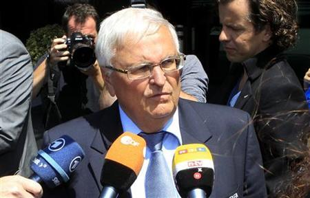 Theo Zwanziger talks to the media after a committee meeting in Zurich July 17, 2012. REUTERS/Arnd Wiegmann/Files