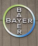 The logo of Germany's largest drugmaker Bayer HealthCare Pharmaceuticals is pictured on the front of its building in Berlin April 28, 2011. REUTERS/Fabrizio Bensch (GERMANY - Tags: BUSINESS HEALTH)