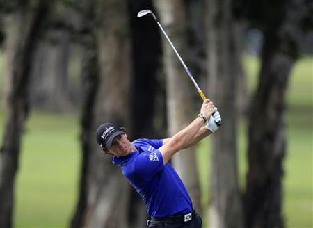 Rory McIlroy from Northern Ireland hits a shot on the sixth fairway during the second day of the Hong Kong Open Championship November 16, 2012. REUTERS/Bobby Yip