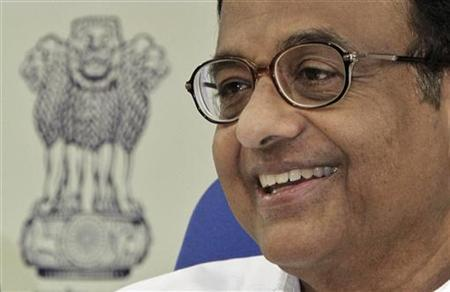 Finance Minister Palaniappan Chidambaram smiles during a news conference in New Delhi October 8, 2012. REUTERS/B Mathur/Files