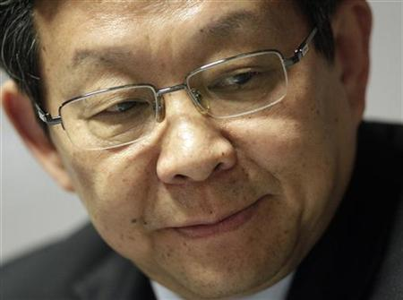 China's Minister of Commerce Chen Deming looks on during a news conference at the 8th World Trade Organization Ministerial Conference in Geneva December 15, 2011. REUTERS/Denis Balibouse